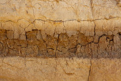 Crumbling wall of clay rock Stock Images