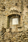Crumbling wall. Crumbling exterior wall with window of an old stone house Royalty Free Stock Photo