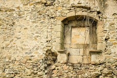 Crumbling wall. Crumbling exterior wall with window of an old stone house Royalty Free Stock Photography