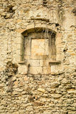 Crumbling wall. Crumbling exterior wall with window of an old stone house Stock Images
