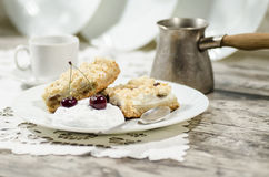 Crumbly cake with cherries and pot of coffee Stock Images