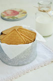 Crumbly cookies in tin box on vintage doily Stock Photo