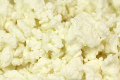 Crumbly fresh cheese  background Stock Photos