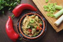 Crumbly pearl barley with vegetables Stock Photos