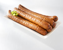 Crumbly sausage on a plate. Fresh crumbly sausage on a plate stock photo