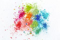 Crumbs of multi-colored chalk on a white background. Joy, Carnival. Panorama. A game for children. Art stock photo