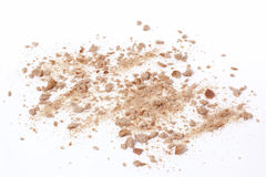 Crumbs scattered on white background Royalty Free Stock Images