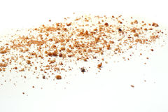 Crumbs on white background - Wide view. Crumbs spread on white background - Wide view Royalty Free Stock Photos