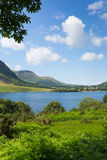 Crummock Water Lake District North West England UK between Buttermere and Loweswater. On summer day with blue sky and white clouds royalty free stock images