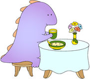 Crummy bellied dragon eats his breakfast: porridge and juice Stock Images