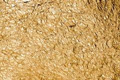 Crumped Goldhintergrund Lizenzfreie Stockbilder