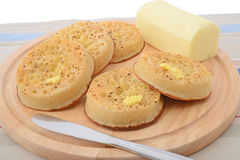 Crumpets with butter Stock Images