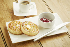 Crumpets toasted on white dish Royalty Free Stock Photo