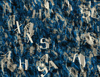 Crumple paper with many abstract blue alphabet letters Stock Photography