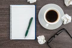 Crumple paper, notebook and pen with cup of coffee Stock Image