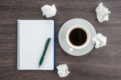Crumple paper, notebook and pen with cup of coffee Royalty Free Stock Photography
