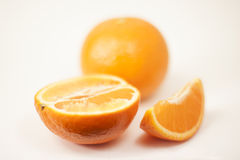 Crumple a tangerine on a white background Stock Images