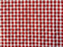 Crumple texture of a red and white checkered picnic blanket Stock Photos