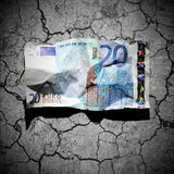 Crumpled 20 euro banknote on dry soil background Royalty Free Stock Photos