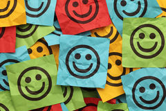 Crumpled adhesive notes with smiling faces Stock Photo