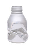 Crumpled aluminium bottle Stock Photo