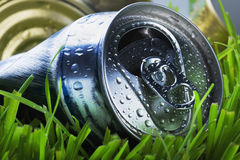 Crumpled aluminum can on a green grass Stock Images