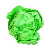 Crumpled ball from green paper isolated on white. Background stock photography