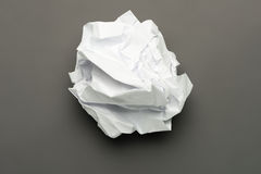 Crumpled Ball of Paper. On Gray Stock Photos