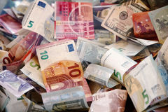 Crumpled banknotes. Banknotes of different countries and wrinkled overlapping randomly. Different colors Stock Photo