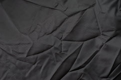 Crumpled black fabric texture Royalty Free Stock Images