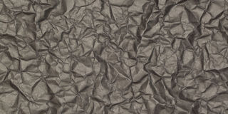Crumpled black paper with blotches Royalty Free Stock Photography