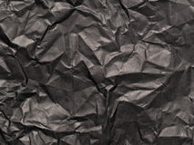 Crumpled black paper Stock Images
