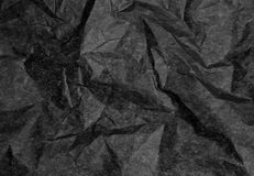 Crumpled Black Paper with Coarse Wrinkles and Fine Texture Royalty Free Stock Image