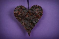 Crumpled black paper heart Stock Image