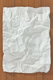 Crumpled blank paper. On wooden table royalty free stock image