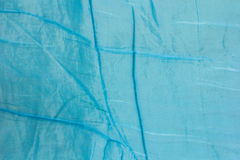 Crumpled blue blanket Royalty Free Stock Photos