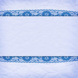Crumpled blue paper with a border of lace Royalty Free Stock Photography