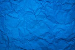 Crumpled of blue paper sheet texture background. Abstract wallpaper in cool tone concept for use in website or wrapping. Texture stock images