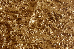 Crumpled bronze metal. Reflective brown chromic metal surface Royalty Free Stock Images