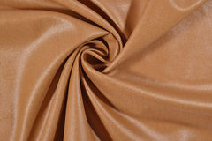 Crumpled brown fabric Stock Photos