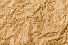 Crumpled brown kraft paper texture Stock Images
