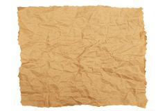 Crumpled brown kraft paper with torn edges. White isolate stock image