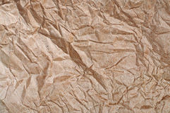 Crumpled Brown Paper. A sheet of crumpled brown paper royalty free stock photos