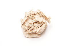 Crumpled brown tissue paper ball. On white background Royalty Free Stock Images