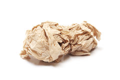 Crumpled brown tissue paper ball. On white background Stock Images