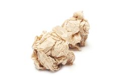 Crumpled brown tissue paper ball. On white background Royalty Free Stock Image