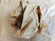 Crumpled brown wax paper wrapper in a ball royalty free stock photos