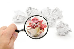 Crumpled canadian dollar ball and magnifier Royalty Free Stock Photo