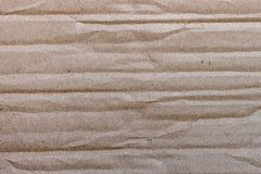 Crumpled cardboard with dirty patches Royalty Free Stock Photo