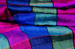 Crumpled checked fabric. Green, green and magenta plaid print as Royalty Free Stock Images